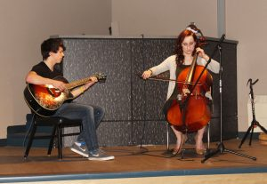 Kaleb Korta, class of 2016, and Natalie Olender, music and arts director, perform in the SUB during the grand opening last year.