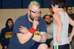Coach Josh Pittsenbarger talks with one of the Little Hawks wrestlers during last year's Intersquad Rumble.