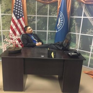 Corey Tuzroyluke ponders the future of the nation in this mock-up of the Oval Office at the conference hall where he attended workshops and meetings during the inauguration.