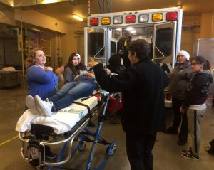 Health sciences teacher Carrie Given, in the blue, were shown the skills needed for paramedics working in an ambulance during their recent visit to Fairbanks for the AHEC conference.