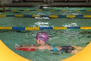 MacKenzie Tulloch, one of the members of the Galena swim team, practices at the community pool.