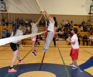 Action at the mixed-6 volleyball tournament.