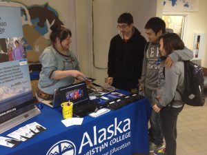 Liz Chase, left, talks with several Galena students visiting her recruiting booth in the composite building commons area.