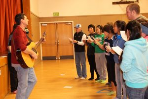 Young Life participants sing a song during their gathering in the SHS elementary gym.
