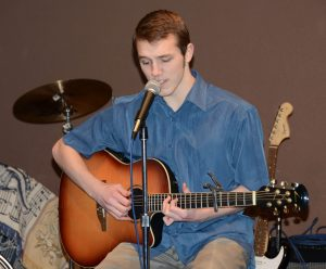 GILA senior Isaac McElwee performs at January's Open Mic Night.