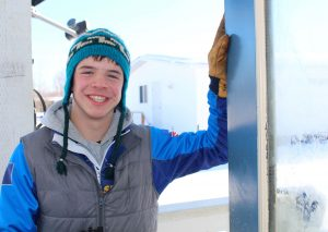 Kaleb Korta, a junior from Galena, was one of the many students who lent a hand and helped out at the Iditarod checkpoint.