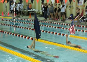 Galena swimmers presented the colors at the start of the swim meet.
