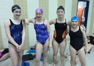 Since Nome didn't have enough swimmers for its relay team, they borrowed Galena swimmers Angelica Firmin (second from left) and Tirzah Bryant (far right). The Nome team also borrowed a swimmer from the Fairbanks Midnight Sun team.