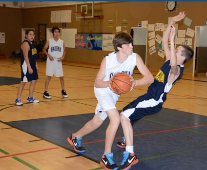 Last years junior high tournament was filled with action. Seventh-grader John Riddle goes up against fellow Galena player Koby Wightman.