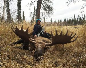 Sixth-grader Ian Esmailka with his first moose. Thanks to Trisha Esmailka for letting us use this photo.