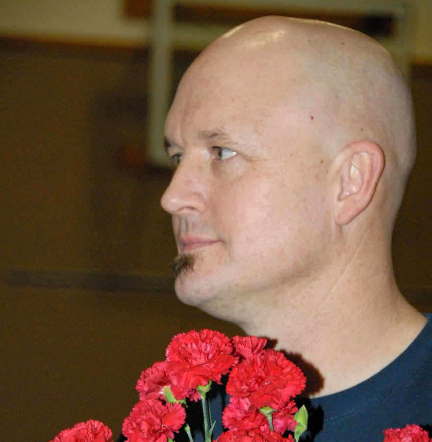 Mr. Buchanan is shown here with the flowers waiting for the parents of seniors on Senior Night, 2014. Among his other duties, Mr. Buchanan helped organize the annual event.