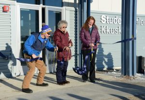 Galena Mayor Jon Korta, elder Jenny Pelkola, and Galena school board president cut the ribbon at the grand opening of the remodeled Student Union Building on the GILA campus.