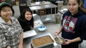 Students Brianna Noratuk, Tiana Chiklak, and Elizabeth Green in the food and nutrition class. Photo courtesy Ruth Ross.