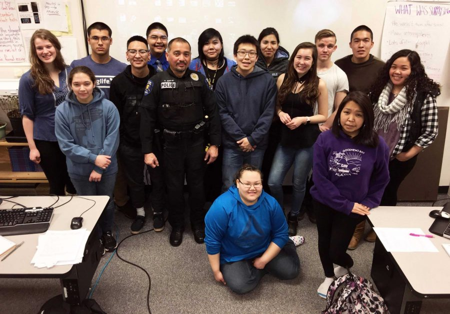 Officer+Vincent+Garay+with+the+Hawk+Highlights+staff+during+his+interview+in+class.