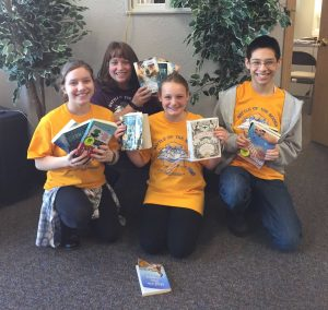 The Galena junior high Battle of the Books team is, from left, Abigail Landrum, coach Genny Brown, Sable Scotton, and Alex Cruz, an IDEA student from Wasilla.