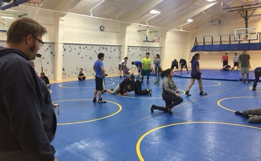 Assistant wrestling coach Josh Pittsenbarger trains the team in early October. Photo by Dana Sours.