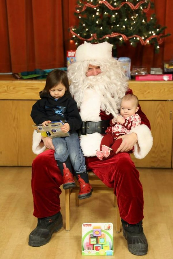 Santa+greets+two+youngsters+at+last+year%27s+Toys+for+Tots+celebration.+Photo+courtesy+Jackie+Lumba.