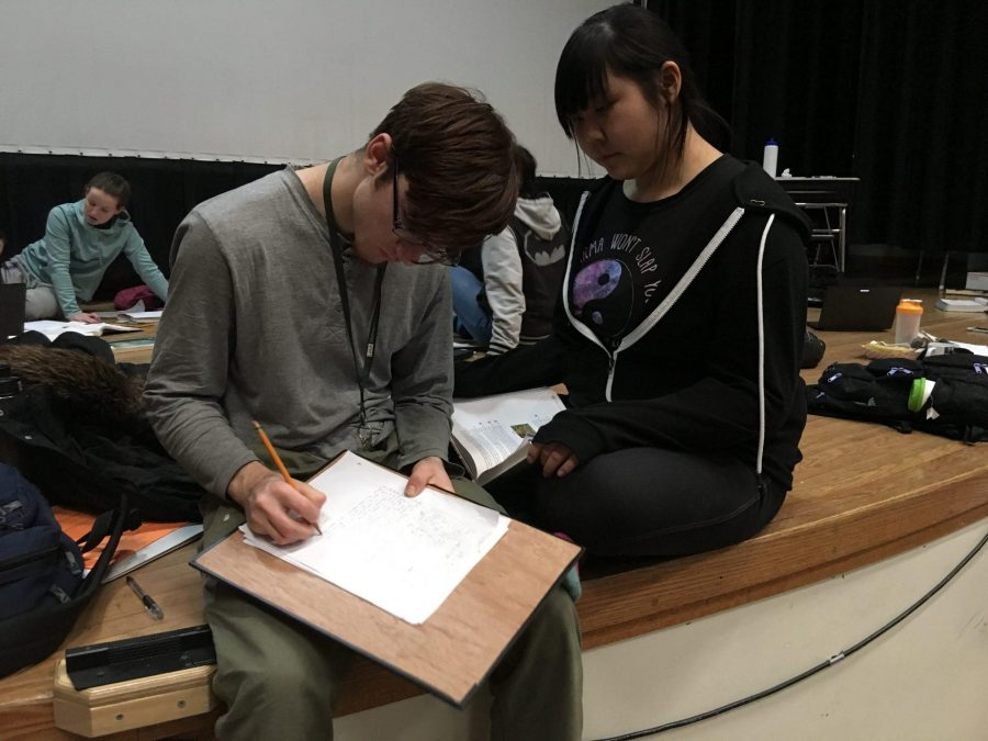 Students work through math problems during class conducted on the GILA auditorium stage on Tuesday afternoon.