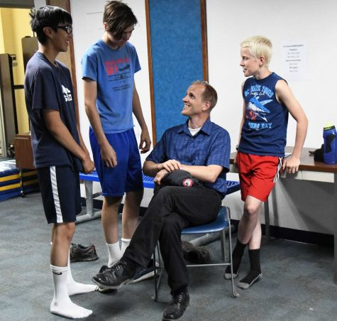 Mr. Merriner talks with members of the Galena Hawks cross-country team this summer.