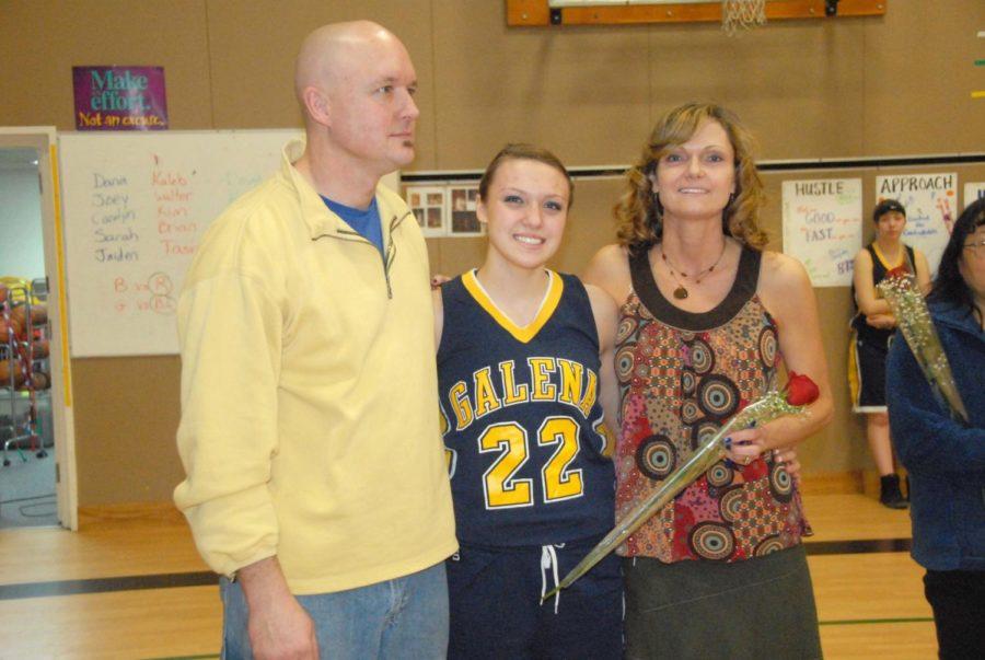 Jenna Buchanan is shown here during the 2012 senior appreciation night ceremony on Feb. 18, 2012, with her parents, Galena athletic director Jon Buchanan and principal Beth Buchanan.