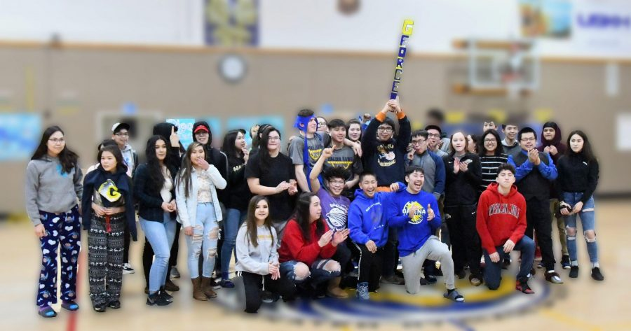 The prize of prizes, the Galena Spirit Stick, is shown here in the hands of the class of 2020, who won the stick during a pep rally in March 2019.