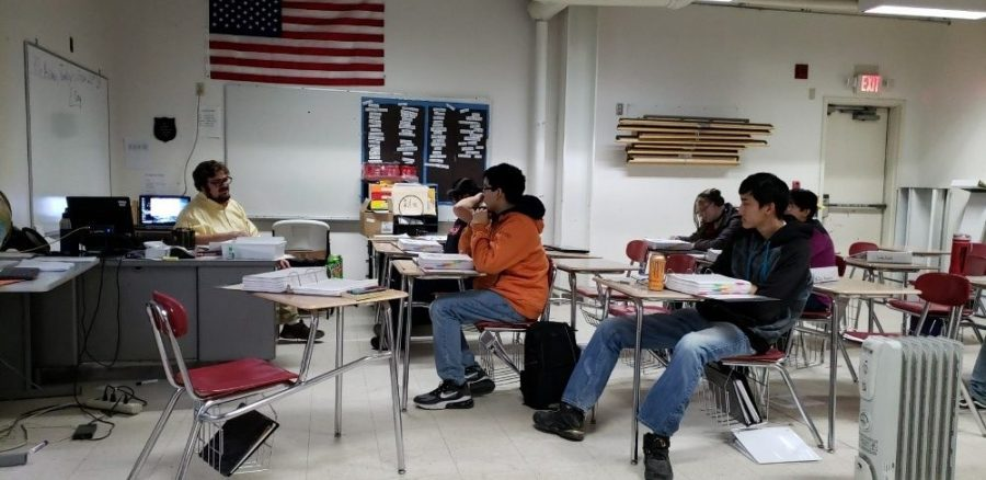 The academic decathlon team preparing for its upcoming tournament.